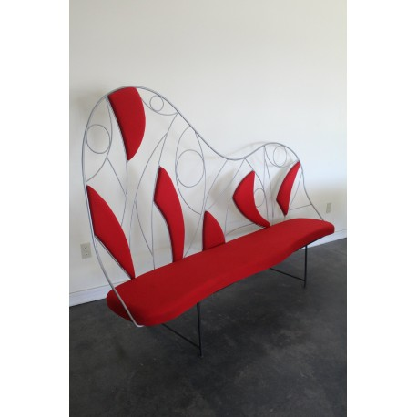 Red couch with steel design